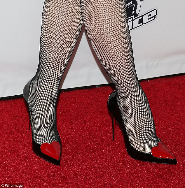 Say it with accessories: Gwen Stefani offset her whimsical shoes with black fishnet tights
